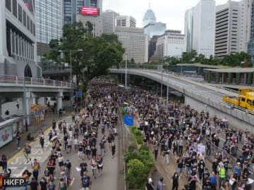 Protesters march through Central. Photo: Holmes Chan/HKFP.