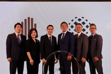Executives from Japan's List Group and Thailand's Habitat Group announce two joint condominium developments in Bangkok on Thursday.