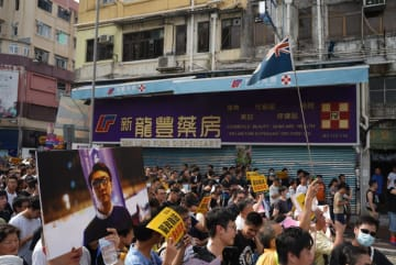 Protesters brought a photo of Edward Leung during a protest in Sheung Shui on July 13, 2019. Photo: inmediahk.net.