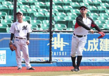 練習中のレアード(右)と中臺打撃投手。ホームランダービーでの共演はレアードの指名によって実現した=ZOZOマリン