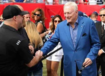 Caption:TAMPA, FL - NOVEMBER 15: Dallas Cowboys owner Jerry Jones talks with fans during a game against the Tampa Bay Buccaneers at Raymond James Stadium on November 15, 2015 in Tampa, Florida. (Photo by Mike Ehrmann/Getty Images)