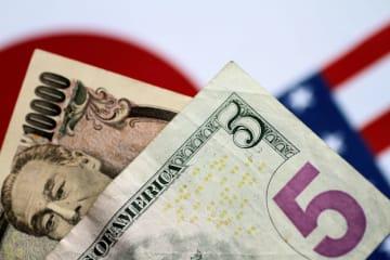 日本円と米ドル(ロイター=共同)