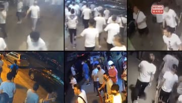 Security camera footage showing men in white shirts on July 21 in Yuen Long. Police did not take action after passing them three times. Photo: RTHK screenshot.