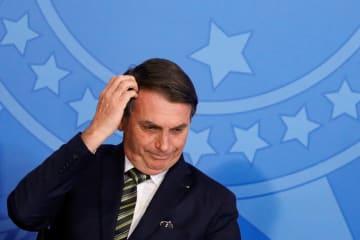 ブラジルの首都ブラジリアで、式典に出席したボルソナロ大統領=7月30日(ロイター=共同)