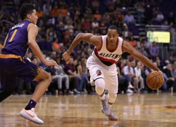 CJ McCollum posts photoshopped Instagram photo of Carmelo Anthony with Blazers jersey