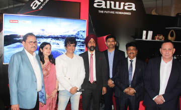 Executives of Aiwa Consumer Products pose before the brand's LED TV in New Delhi on Thursday.