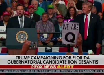 What Is QAnon? Right Wing Conspiracy Group Makes Appearance At Florida Trump Rally