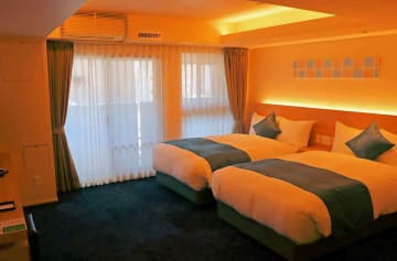 「繭 グレイスホテル」のデラックスルーム