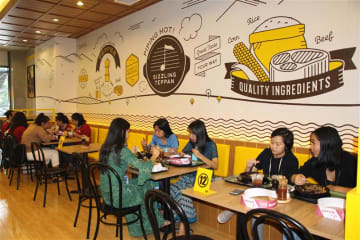 Diners enjoy food at Pepper Lunch's first restaurant in Myanmar on Aug. 2.