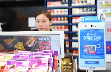 中国のモバイル決済企業、統合決済への布石加速