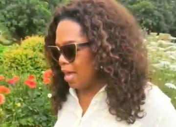 Oprah in her Maui flower garden