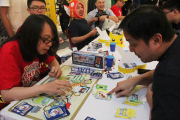 Two participants engage in a Pokemon trading card game at an event in Jakarta, Indonesia, on Aug. 8, 2019. (NNA/Kyodo)