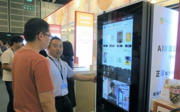 プロダクトリングは、自動販売機を活用した海外輸出ビジネスで年内に香港現地法人を設立する=15日、湾仔(NNA撮影)