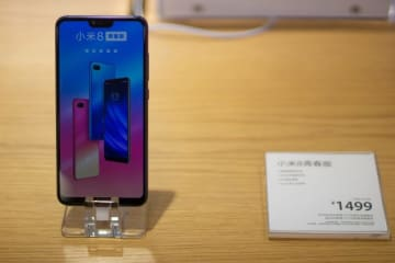 A Mi 8 phone sits on display in a Xiaomi store in Shanghai on March 22, 2019. (Image credit: TechNode/Cassidy McDonald)