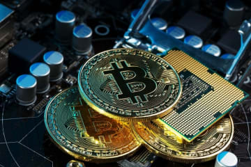 Golden bitcoin cryptocurrency on a computer board. (Image credit: Bigstock/alexgrec)