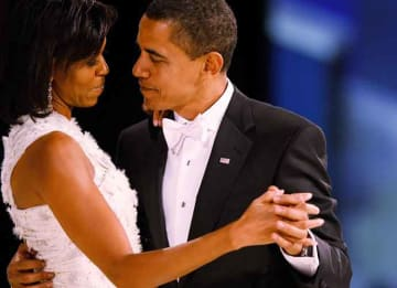 Photo: WASHINGTON - JANUARY 20: (AFP OUT) US President Barack Obama dances with his wife and First Lady Michelle Obama during the Western Inaugural Ball on January 20, 2009 in Washington, DC. President Barack Obama was sworn in as the 44th...