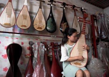 楽器製造で暮らしを豊かに 河南省蘭考県