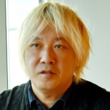 「棄損された表現の自由をリカバリーしたい」と語る津田大介さん=26日午後、東京都港区