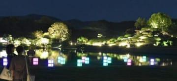 「灯篭」の光で幻想的に彩られた後楽園の沢の池=29日午後7時18分