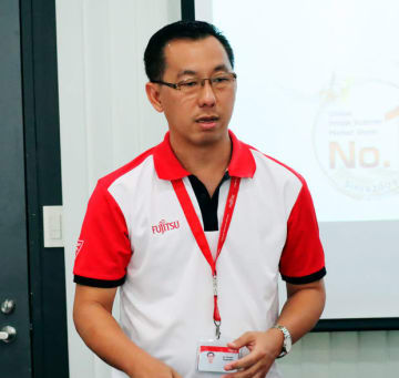 Fujitsu (Thailand) Co.'s plan to boost scanner sales is explained by Pornchai Ponganekkul, director of Digital Infrastructure and Business Alliance, in Bangkok on Aug. 27.