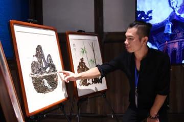 廃棄物が宝に お茶で絵を描くアーティスト 福建省