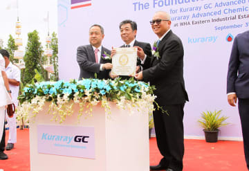 Supattanapong Punmeechaow (R), president and CEO of PTT Global Chemical Public Co., Hiroshi Yamamoto (C), president of Kuraray GC Advanced Materials Co., and Shingo Ueno (L), senior managing executive officer of Sumitomo Corp., poses at a cornerstone