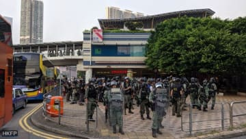 Riot police deploy in force in Tung Chung. Photo: Holmes Chan/HKFP.