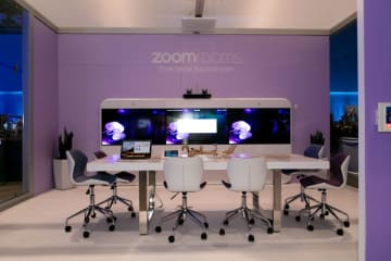 A booth displaying an empty conference room with Zoom's video conferencing tools. (Image credit: Zoom)