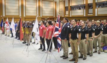 「国際防衛ラグビー競技会」の開会式で整列する各国チーム=9日午後、防衛省