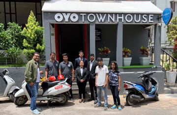 Oyo users pose with Drivezy's bikes stationed at an Oyo hotel in Bengaluru on June 17, 2019.