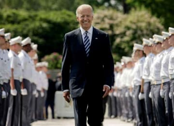 WEST POINT, NY - MAY 26: U.S. Vice President Joe Biden makes his way down a row of cadets as he arrives to address to graduates of The United States Military Academy at West Point May 26, 2012 in West Point, New York. Approximately 1,000...