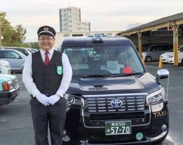 「毎日の仕事が楽しい」と話す熊本タクシーの三次幸介さん=熊本市