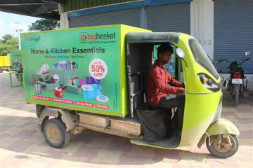 A GMW e-cargo vehicle carries grocery items for delivery from Bigbasket's warehouse in the southern Indian city of Hyderabad on Aug. 27, 2019.