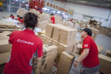 JD.com staff at a company distribution center in Gu'an located in northeast China. (Image credit: Bigstock/XiXinXing)