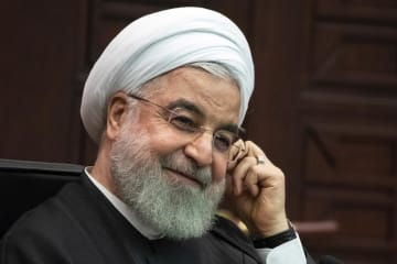 トルコ・アンカラで記者会見に出席したイランのロウハニ大統領=16日(AP=共同)