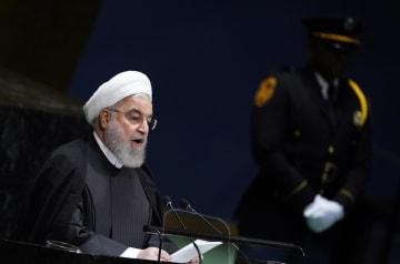 国連総会で演説するイランのロウハニ大統領=25日、米ニューヨーク(ロイター=共同)