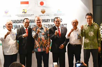 Masafumi Ishii(3rd from L), Japanese Ambassador to Indonesia, Budi Karya Sumadi (2nd from L), Indonesia's transportation minister, and other government officials of Japan and Indonesia pose at a signing ceremony of summary record on a Jakarta-Surabay