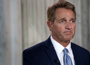 WASHINGTON, DC - OCTOBER 24: Sen. Jeff Flake (R-AZ) speaks to reporters on Capitol Hill after announcing he will not seek re-election October 24, 2017 in Washington, DC. Flake announced that he will leave the Senate after his term ends in 14...