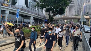 Protesters march a day after a teenage student was shot by police. Photo: Apple Daily.