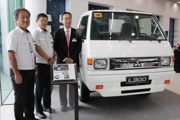 Senior officials with Mitsubishi Motors Philippines Corp. pose with the new L300 model on Sept. 27, 2019.