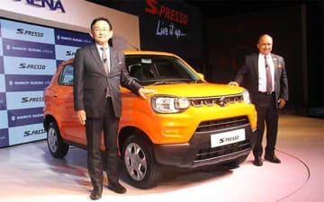 Maruti Suzuki India Managing Director and CEO Kenichi Ayukawa unveils the mini-SUV S-Presso at a presentation event in New Delhi on Sept. 30, 2019.