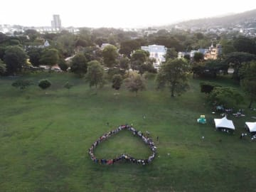 Participants in the Heart for Amazon event form the shape of a heart in front of White Hall in Port of Spain, Trinidad, on September 28, 2019. Photo courtesy Jonathan Barcant, used with permission.