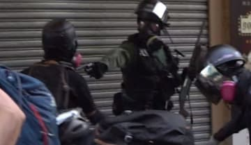 Police fire live ammo at a protester in Tsuen Wan. Photo: Campus TV, HKUSU screenshot.