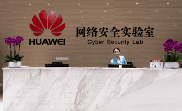 A staff member stands at the front desk of Huawei's Cyber Security Lab in Dongguan. (Image credit: TechNode/Shi Jiayi)