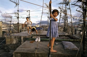 Greg Girard's 'Children playing on Walled City rooftop'. Photo: Christina Jensen/Blue Lotus.
