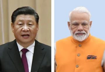 中国の習近平国家主席(左)、インドのモディ首相