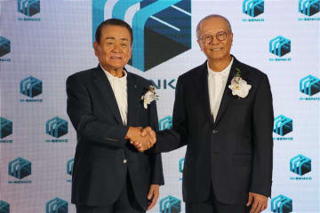 Yasuhisa Fukuda (L), chairman of Senko Group Holdings Co., and Rit Thirakomen, chairman of MK Restaurant Group Public Co., shake hands at the opening ceremony of their joint venture's cold storage warehouse in Samut Prakan Province, south of Bangkok,
