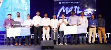 Kenichi Ayukawa (5th from R), managing director and CEO of Maruti Suzuki India Ltd., poses with representatives of five startups for the automaker's mobility and automobile innovation lab program, in New Delhi on Oct. 14, 2019. (Photo courtesy of Mar