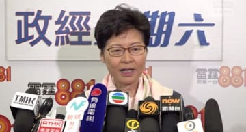 Carrie Lam speaking to reporters after a radio programme. Photo: RTHK screenshot.