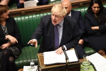 22日、英下院に出席したジョンソン首相=ロンドン(ロイター=共同)